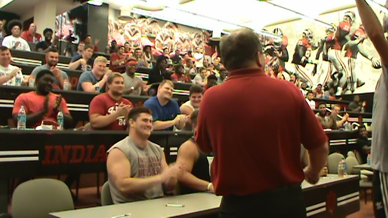 hypnotist Chris Cady demonstration hypnosis with a football mental game toughness