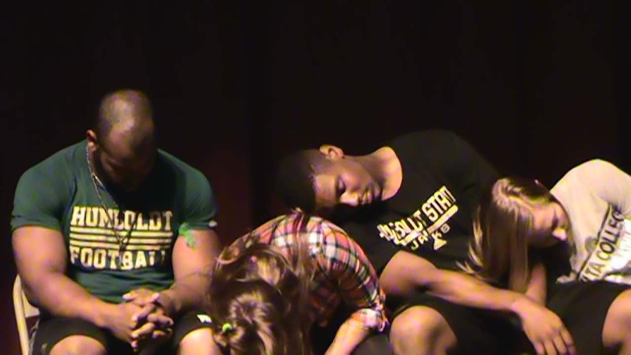 sports hypnosis with college athletes football and valleyball and rowing athletes hypnotized on stage by hypnotist chris cady